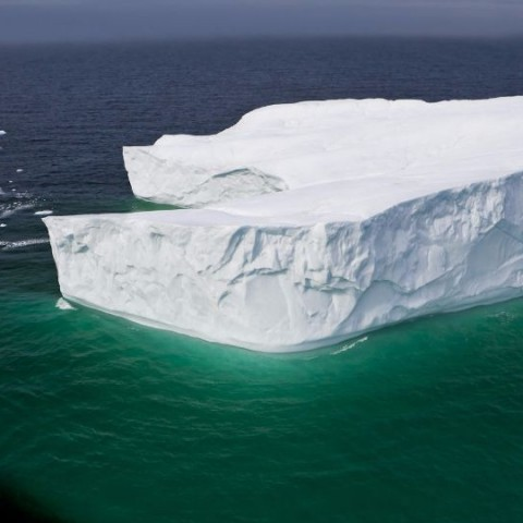 Aerial view of an iceberg in the Strait of Belle Isle, Southern Labrador, Labrador, Newfoundland Labrador, Canada.